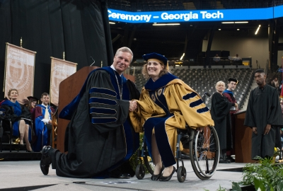 graduating student in wheelchair photo