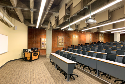 Room with projector and many seats