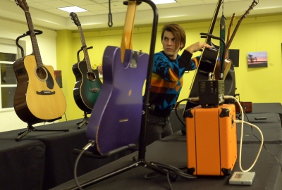 tech professional with guitars